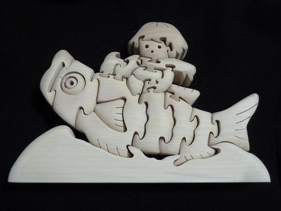 鯉に乗った少年